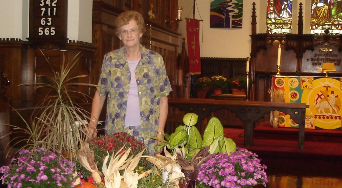 woman with flowers at front of church
