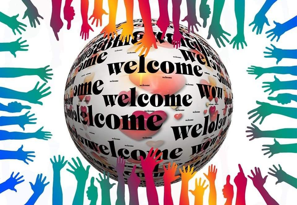Graphic showing globe with welcome written all over