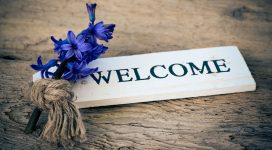 graphic of flowers and welcome text